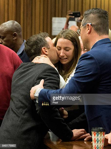 Olympic athlete Oscar Pistorius embraces his sister Aimee Pistorius after sentencing at the High Court on July 6 2016 at the High Court in Pretoria...