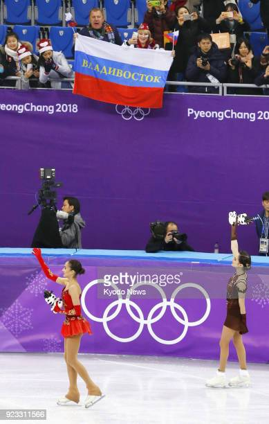 Olympic Athletes from Russia Alina Zagitova and Evgenia Medvedeva acknowledge spectators after finishing first and second respectively in the women's...