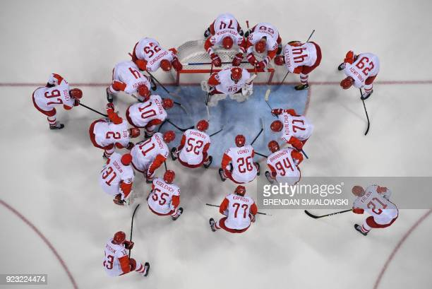 TOPSHOT Olympic Athletes from Russia gather around the net before the men's semifinal ice hockey match between the Czech Republic and Olympic...