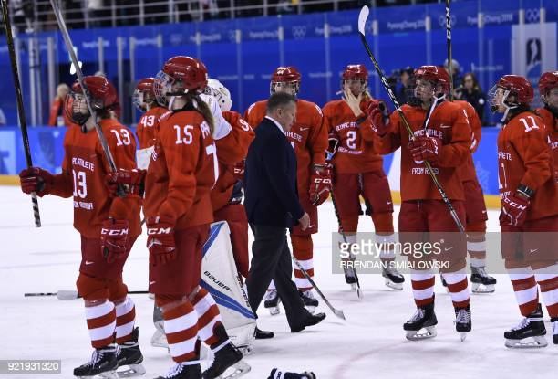 TOPSHOT Olympic Athletes from Russia's coach Alexi Chistyakov walks off the ice after their defeat in the women's bronze medal ice hockey match...