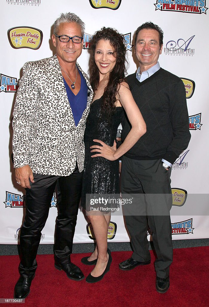 Olympic athletes Greg Louganis, Tai Babilonia and Randy Gardner arrive at the All Sports Film Festival closing ceremony honoring Bruce Jenner at El Portal Theatre on November 11, 2013 in North Hollywood, California.