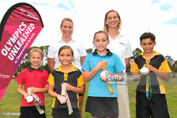 Olympic athletes Monique Murphy and Maddie Groves pose for photographs with students during a visit to Bracken Ridge Primary School on February 15...