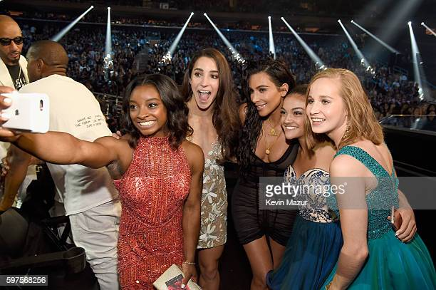 Olympic athletes Simone Biles Aly Raisman Laurie Hernandez and Madison Kocian pose with Kim Kardashian West at the 2016 MTV Video Music Awards at...