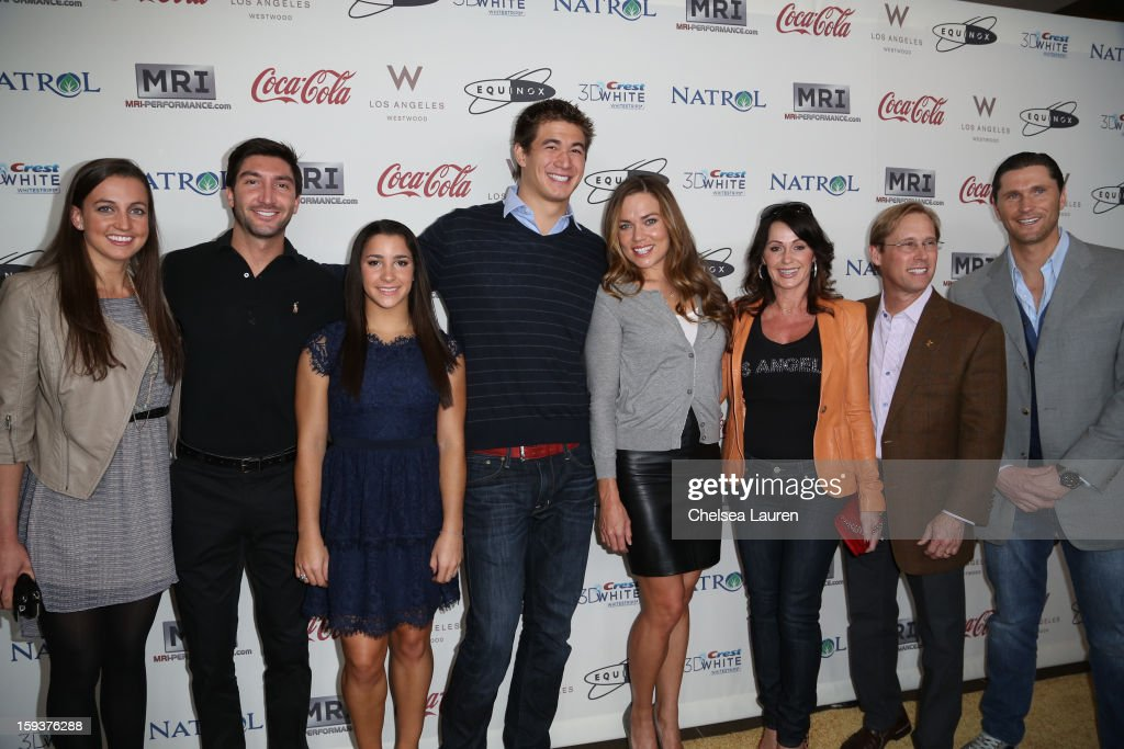 Olympic athletes swimmer Rebecca Soni, figure skater Evan Lysacek, gymnast Aly Reisman, swimmer Nathan Adrian, swimmer Natalie Coughlin, gymnast Nadia Comaneci, gymnast Bart Conner and swimmer Lenny Krayzelburg arrive at CW3PR Presents 'Gold Meets Golden' at Equinox Sports Club on January 12, 2013 in Los Angeles, California.
