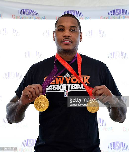 Olympic basketball gold medalist Carmelo Anthony visit children at the the 2012 Garden Of Dreams Foundation's Dream Week event at the MSG Training...