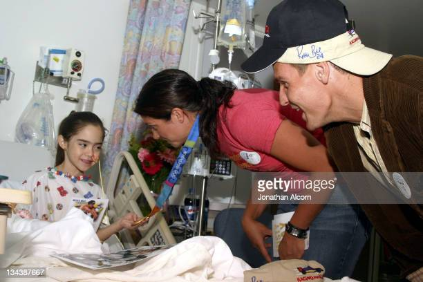 """Olympic beach Volleyball gold medalist Misty May and Ingo Rademacher of """"General Hospital"""" visit with Brianna Michele, age 7, at Miller Children's..."""