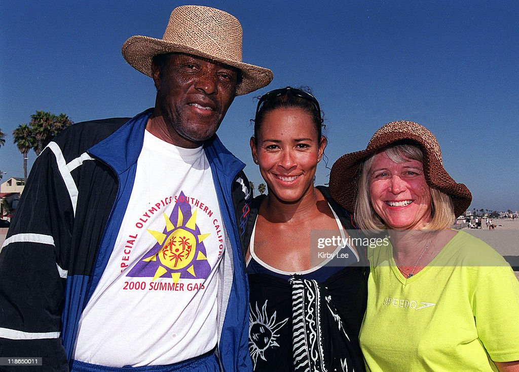 Olympic Beach Volleyball hopeful Jennifer Johnson-Jordan (center) poses with father Rafer Johnson, the 1960 Olympic Decathlon gold medalist (left) and mother Betsey Johnson.