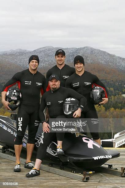 Portrait of USA four man bobsled team Steve Mesler Steve Holcomb Curt Tomasevicz and Justin Olsen at Bobsled Track Lake Placid NY CREDIT Nancie...