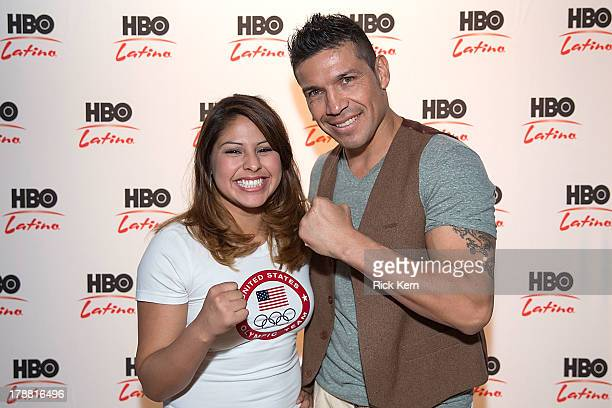 Olympic boxer Marlen Esparza and middleweight champion Sergio Martinez pose during HBO Latino KnocksOut Bullying at Sidney Lanier High School Alumni...