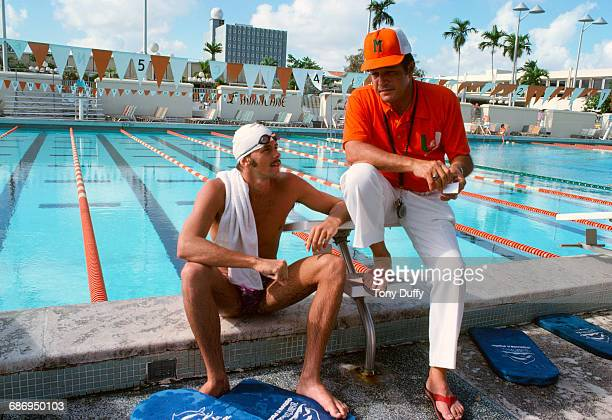 Olympic breastroke swimmer David Wilkie of Great Britain and the Miami Hurricanes talking with swimming coach Bill Diaz during training on 1 March...