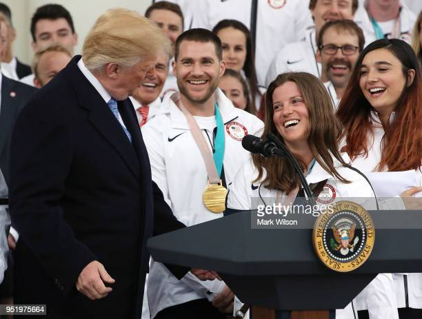 Olympic bronze medalist snowboarder Arielle Gold laughs with US President Donald Trump during a celebration of the USA 2018 Winter Olympic and...