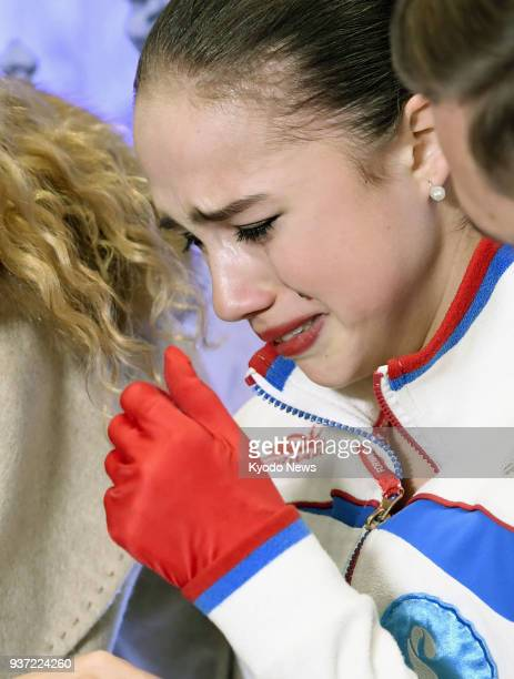 Olympic champion Alina Zagitova of Russia cries after falling three times in her free program at the world figure skating championships in Milan on...