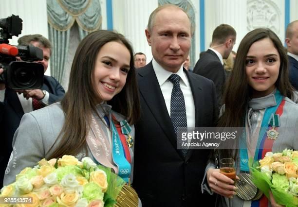 Olympic champion figure skater Alina Zagitova Russia's President Vladimir Putin Olympic silver medallists figure skater Evgenia Medvedeva at a...