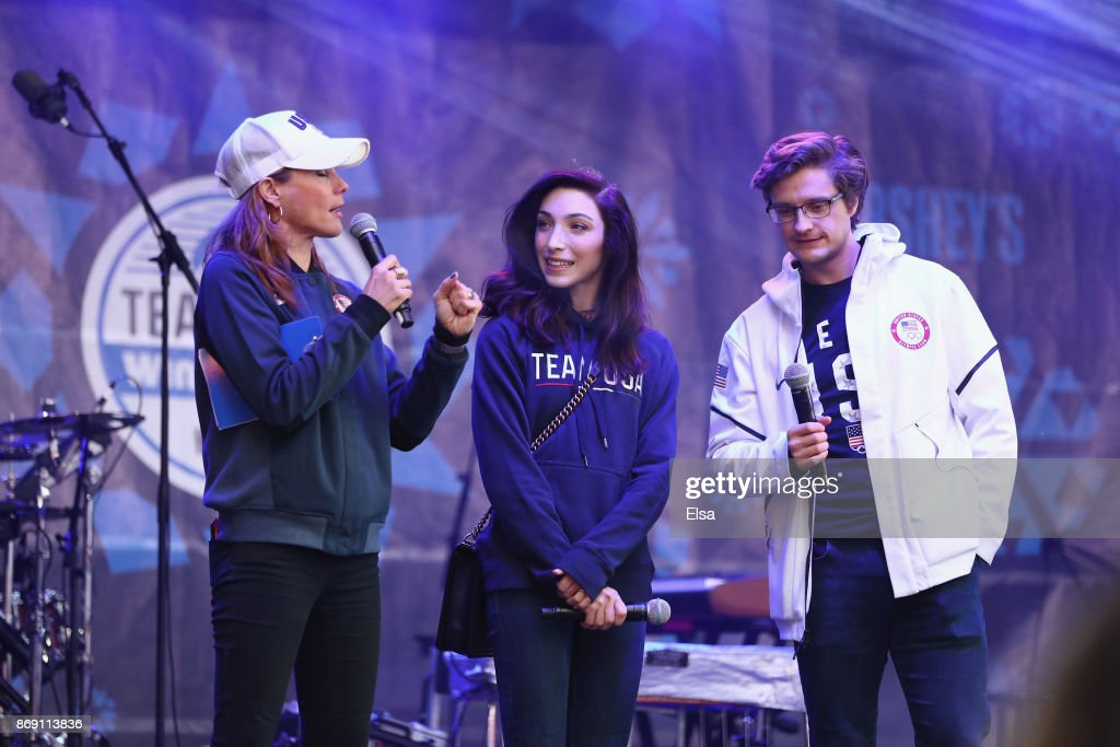 Olympic champion figure skaters Meryl Davis (C) and Charlie White (R) are interviewed during the 100 Days Out 2018 PyeongChang Winter Olympics Celebration - Team USA in Times Square on November 1, 2017 in New York City.