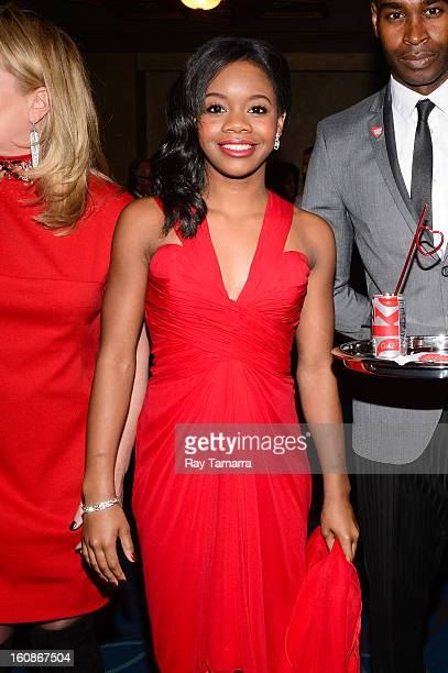 S Olympic champion Gabrielle Douglas attends The Heart Truth's Red Dress Collection Fall 2013 MercedesBenz Fashion Show at 499 Seventh Avenue on...