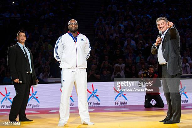 Olympic Champion Teddy Riner of France and former judoka David Douillet of France smile during the Paris Grand Slam 2015 at the Palais Omnisports de...