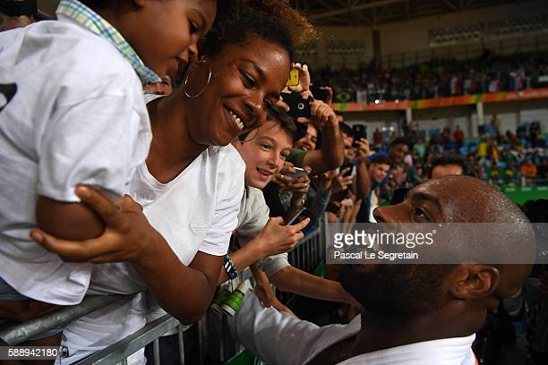 Olympic champion Teddy Riner of France greets his son Eden and girfriend Luthna Plocus after his Men's 100kg Judo final match on Day 7 of the Rio...