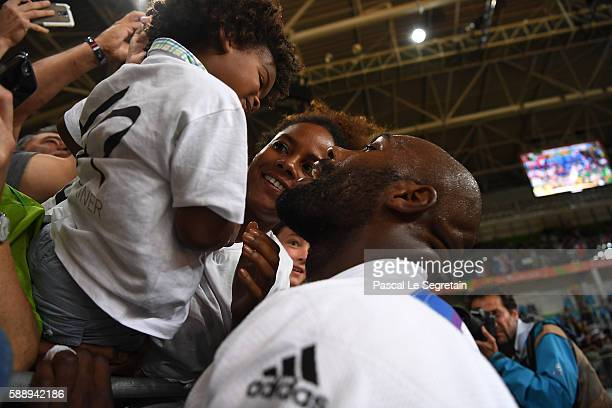 Olympic champion Teddy Riner of France is seen with his son Eden and girfriend Luthna Plocus after his Men's 100kg Judo final match on Day 7 of the...