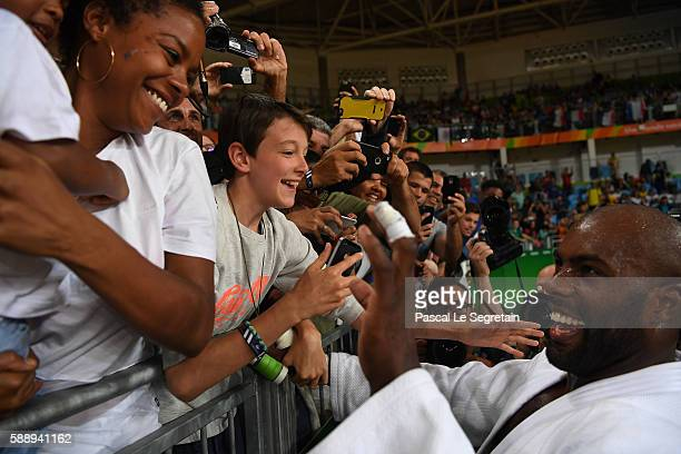 Olympic champion Teddy Riner of France waves to his son Eden and girfriend Luthna Plocus after his Men's 100kg Judo final match on Day 7 of the Rio...