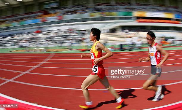 Olympic champion Xing Huina of China competes during the final of women's 5000 meters race at the 4th East Asian Games on November 4 2005 in Macau...