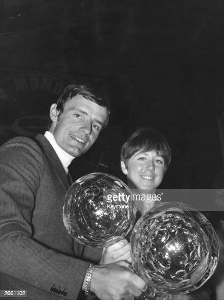 Olympic champions JeanClaude Killy of France and Nancy Greene of Canada display their World Cup skiing trophies at Evian Original Publication People...