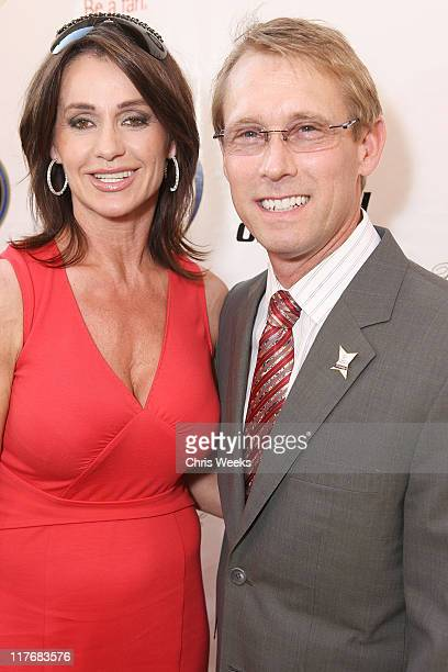 Olympic Champions Nadia Comaneci and Bart Conner attend the Global Football Reception at Cafe Santorini on July 20, 2009 in Pasadena, California.
