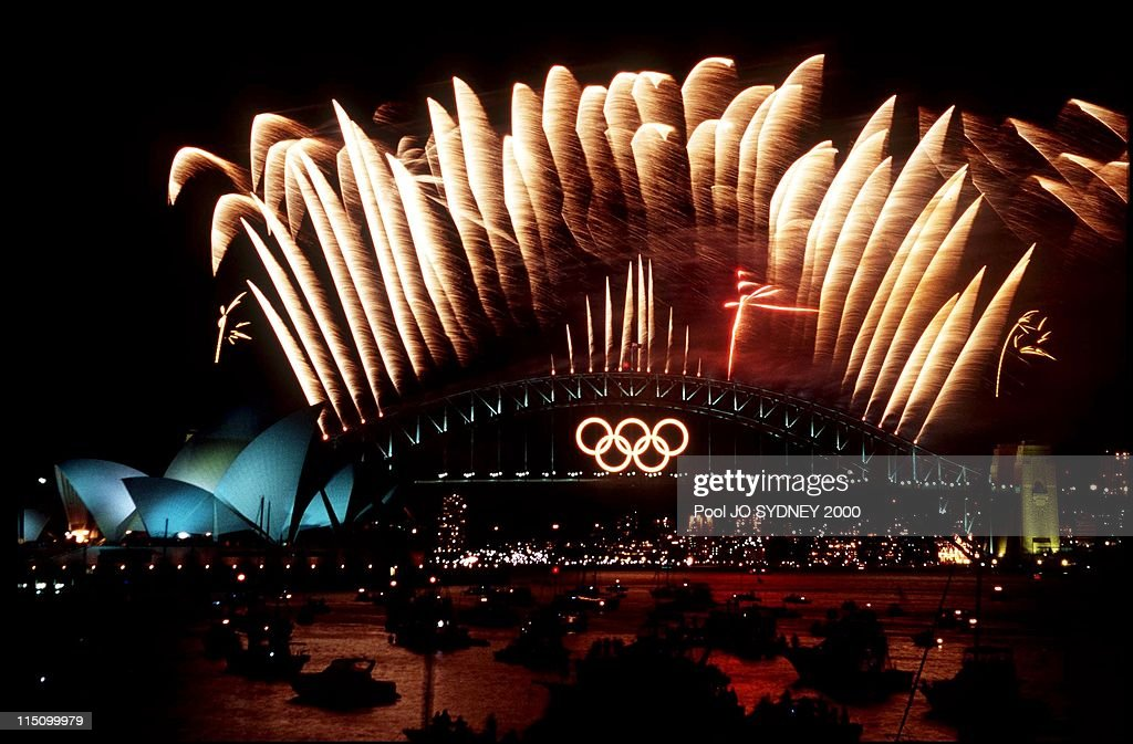 Olympic Closing Ceremony Fireworks Display Over Sydney Harbor And Opera House In Sydney, Australia On October 01, 2000. : News Photo