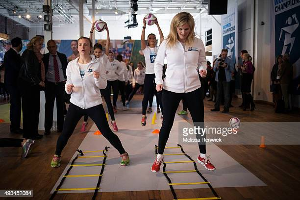 TORONTO ON APRIL 7 Olympic curler Jennifer Jones walks through a training exercise with a young athlete during the Fuelling Women Champions event at...