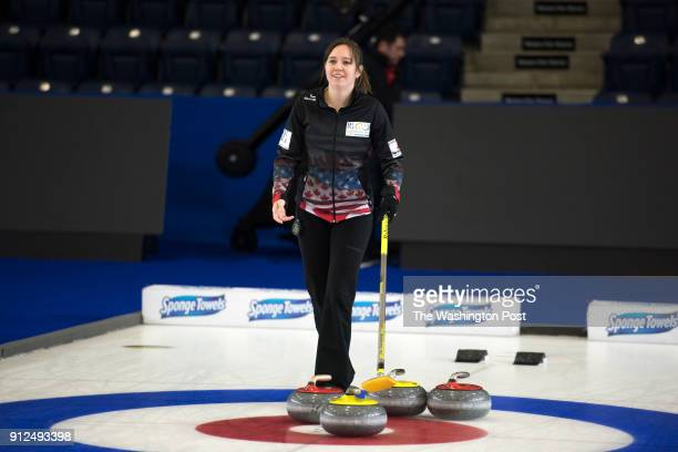 S Olympic curling team member Aileen Geving helps guide in a stone during practice at the Western Fair Sports Centre in London Ontario on January 10...