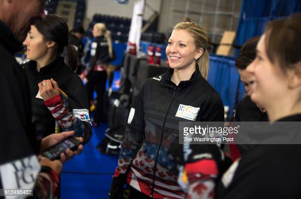 S Olympic curling team member Nina Roth right smiles as she talks to her teammates during practice at the Western Fair Sports Centre in London...