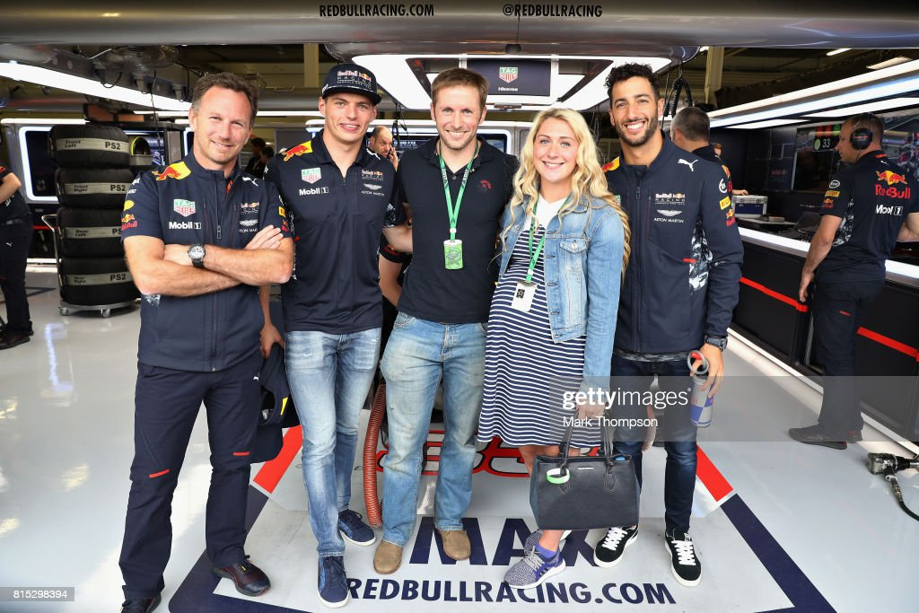 Olympic cycling gold medallist Jason Kenny and his Olympic cycling gold medallist wife Laura pose for a photo with Red Bull Racing Team Principal Christian Horner, Max Verstappen of Netherlands and Red Bull Racing and Daniel Ricciardo of Australia and Red Bull Racing at the Red Bull Racing garage before the Formula One Grand Prix of Great Britain at Silverstone on July 16, 2017 in Northampton, England.