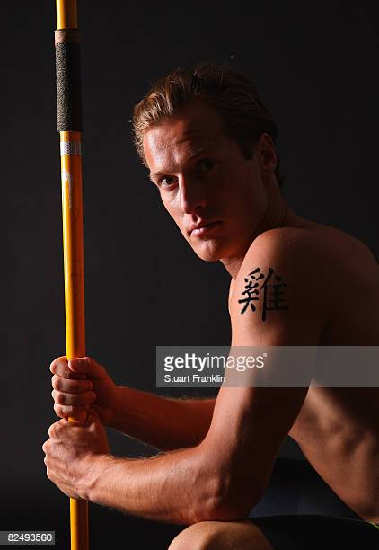 Olympic decathlete Andre Niklaus is seen with his Chinese Zodiac sign Rooster during a photo session on July 3 2008 in Berlin Germany