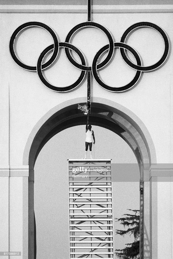 Olympic decathlon gold medal winner Rafer Johnson stands atop a stairway to light the Olympic rings which will, in turn, light the Olympic Flame at the Opening Ceremonies of the 1984 Summer Olympics in Los Angeles. July 28, 1984.