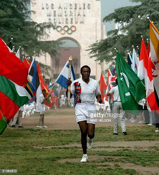 Olympic Decathlon Gold Medalist Rafer Johnson, of the US, leaves the Olympic Flame ceremony 27 April at the Los Angeles Memorial Coliseum. Johnson...