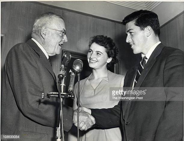 Olympic discus champion Harold Connolly with Olga Fikotova being greeted by Secretary of State John Foster Dulles