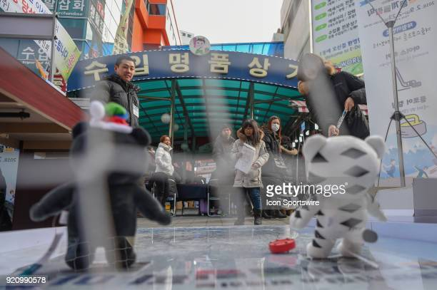 Olympic fans flying through Seoul South Korea braved the cold long enough to enjoy a hockey slap shot contest on a mini ice rink before making their...