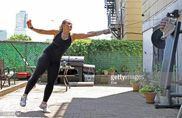 Olympic fencer Dagmara Wozniak runs through drills on a make shift opponent during a training session in her back yard on June 10 2020 in Jersey City...