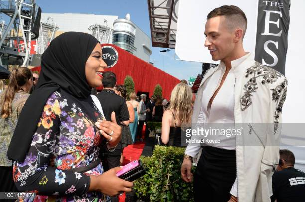 Olympic fencer Ibtihaj Muhammad and Olympic figure skater Adam Rippon attend the 2018 ESPY Awards Red Carpet Show Live! Celebrates With Moet &...