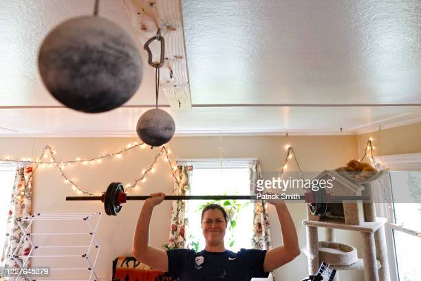 S Olympic fencer Katharine Holmes lifts weights as she trains at her home on May 28 2020 in Princeton New Jersey An Olympian World Championship gold...