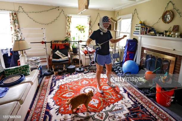 S Olympic fencer Katharine Holmes pauses as she trains with her boyfriend Tyler Christensen during a training session at her home on May 28 2020 in...