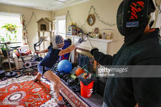S Olympic fencer Katharine Holmes trains with her boyfriend Tyler Christensen during a training session at her home on May 28 2020 in Princeton New...