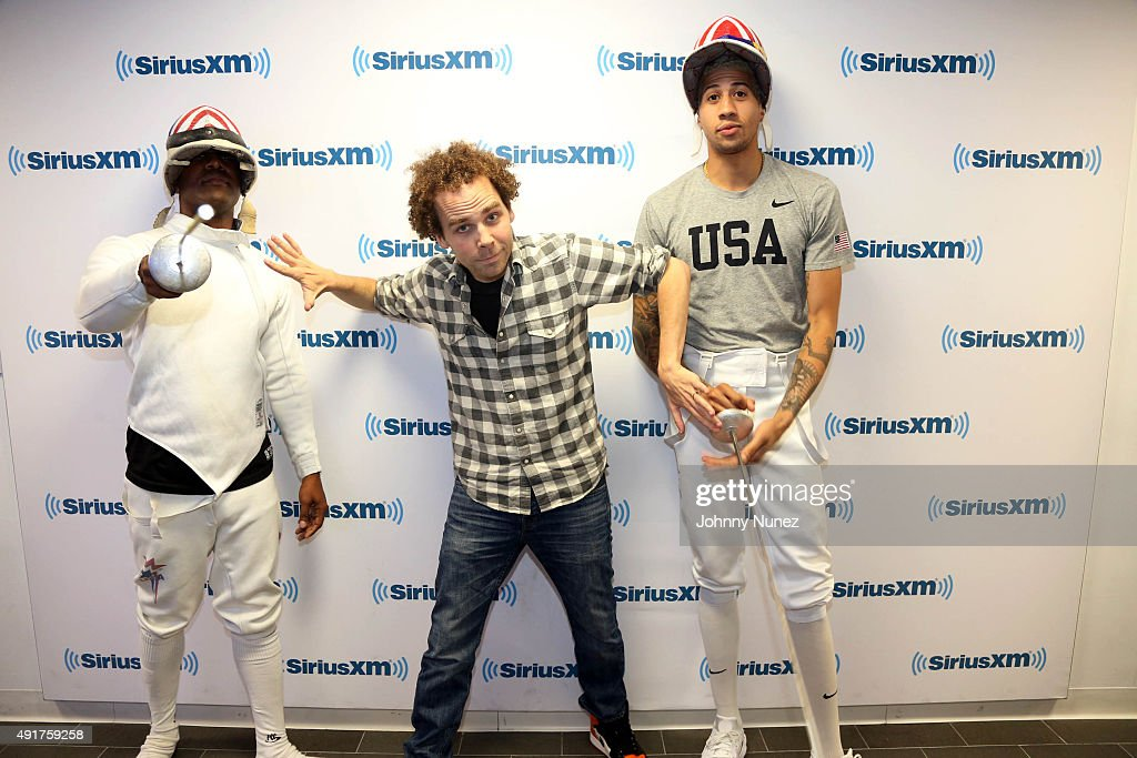 Olympic fencer Miles Chamley-Watson (R) Invades 'The Whoolywood Shuffle' with hosts DJ Whoo Kid (L) and Sam Roberts (C) at SiriusXM Studios on October 7, 2015, in New York City.