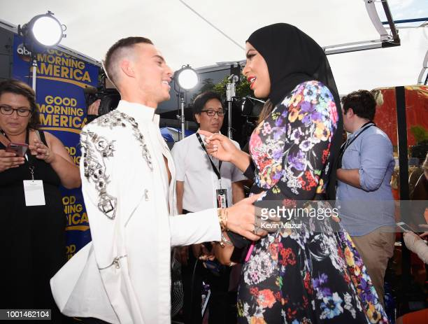 Olympic figure skater Adam Rippon and Olympic fencer Ibtihaj Muhammad attend the The 2018 ESPYS at Microsoft Theater on July 18, 2018 in Los Angeles,...