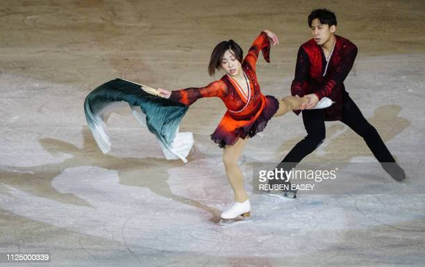 Olympic figure skaters Sui Wen Jing and Han Cong of China perform during the '26th Paektusan Prize Figure Skating Festival in Celebration of the Day...