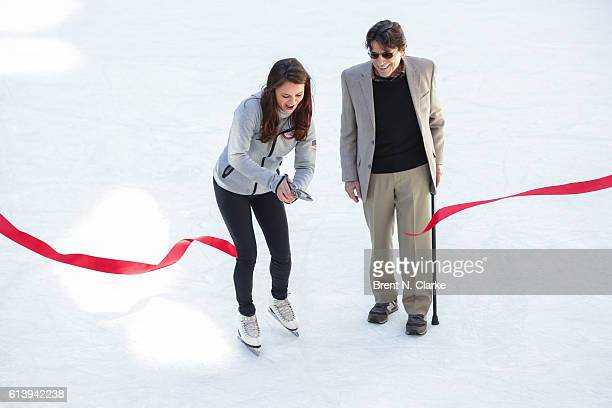 Olympic figure skating champion Sasha Cohen and choreographer Edward Villella cut the ribbon during The Rink at Rockefeller Center's 80th Anniversary...