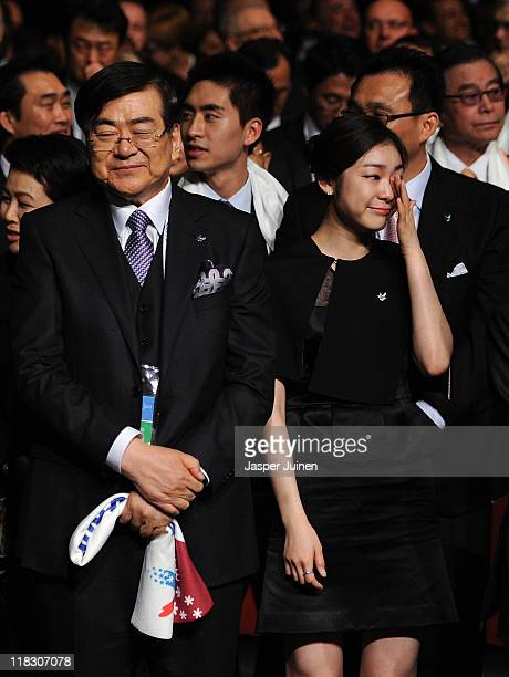 Olympic figure skating champion Yuna Kim reacts besides bid chairman Yang Ho Cho as PyeongChang is choosen as the host city for the 2018 Olympic...