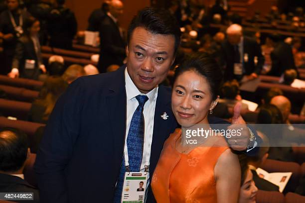 Olympic Figure Skating champions Shen Xue and Zhao Hongbo attend a party of the 128th IOC Session on July 30 2015 in Kuala Lumpur Malaysia