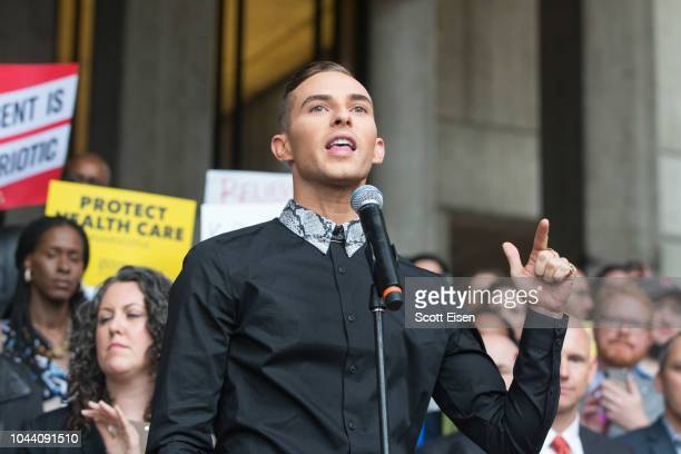 S Olympic figure skating gold medalist Adam Rippon speaks at a rally calling on Sen Jeff Flake to reject Judge Brett Kavanaugh's nomination to the...