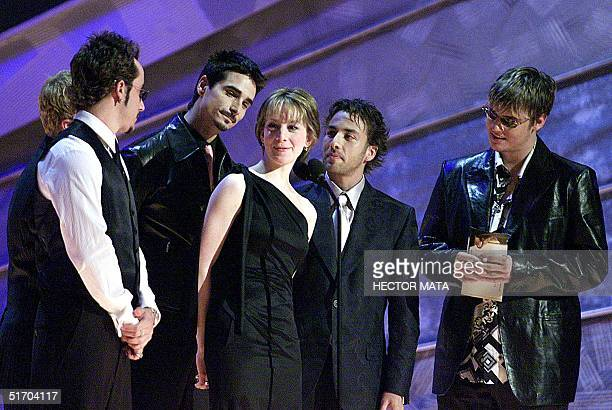 Olympic figure skating gold medalist Sarah Huges is surrounded by members of The Backstreet Boys on the stage at the 44th Annual Grammy Awards in Los...