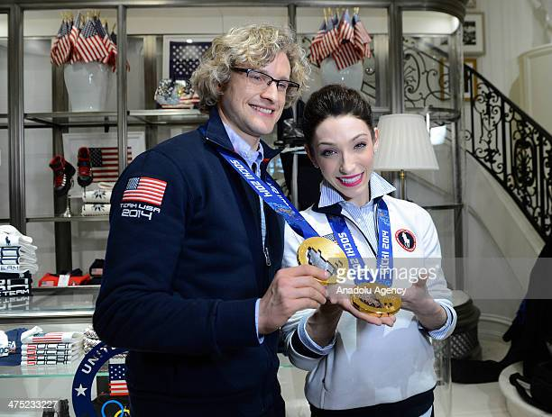 Olympic figure skating gold medalists Meryl Davis and Charlie White pose to media during the signing ceremony in New York on February 26, 2014.